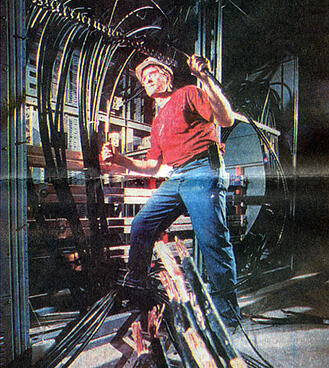IMG: Electrician working with power distribution,1995