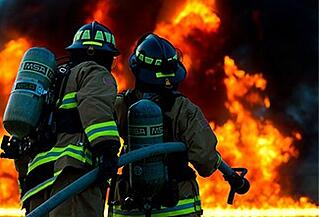 Image of fire fighters practicing fire safety