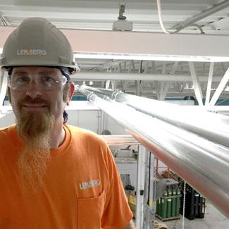 Brandon, electrician on the job at Metalspun