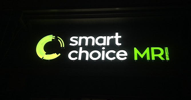 Evening image of illuminated Smart Choice MRI sign.