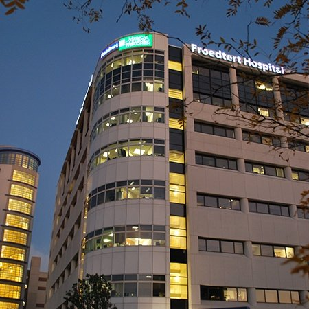 Image of the Froedtert & the Medical College of Wisconsin North Tower at night with new LED signs.